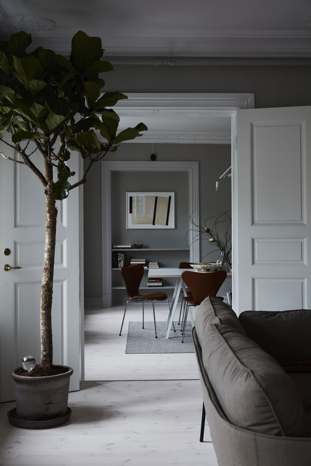 Tour the Dark, Serene and Homey Workspace of a Swedish Financial Firm